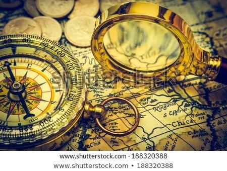Investment - Magnifying Glass on Old Paper. Stock photo © tashatuvango