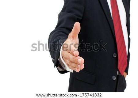 handsome businessman offering handshake over white background stock photo © deandrobot