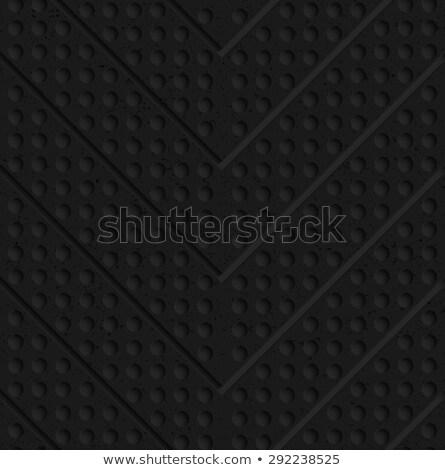 Black textured plastic chevron in small holes Stock photo © Zebra-Finch