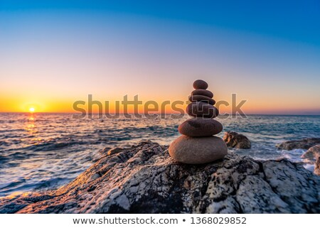 pile of stacked stones at the beach stock photo © inxti