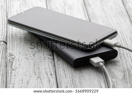 charging a smartphone from powerbank on white stock photo © adamr