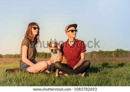 young woman wearing sunglasses walking in the fields Stock photo © feedough