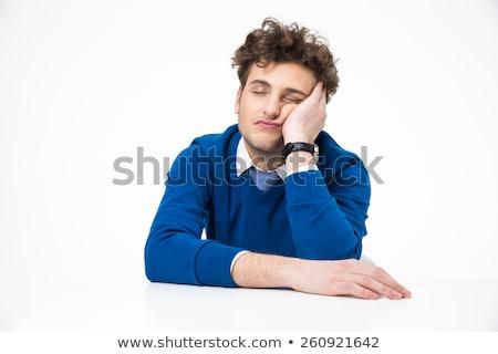 Fáradt férfi göndör haj alszik asztal iroda Stock fotó © wavebreak_media