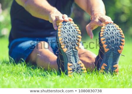Férfi atléta sportruha felfelé fut stadion Stock fotó © deandrobot