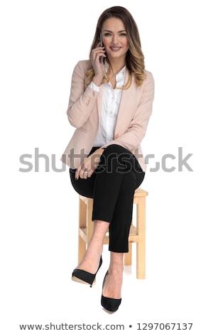 Felice giovani casuale donna seduta sgabello Foto d'archivio © feedough
