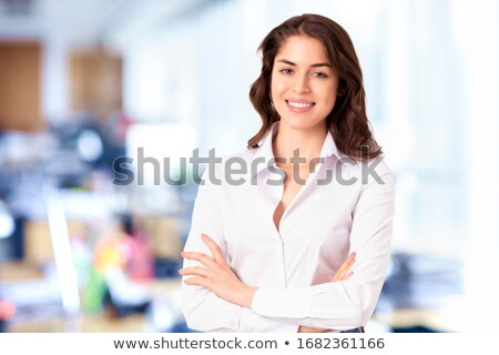 Friendly businesswoman portrait with crossed arms Stock photo © Minervastock
