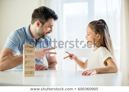 kids playing rock-paper-scissors game at home Stock photo © dolgachov