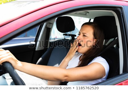 Woman Yawning While Driving Car Stock photo © AndreyPopov