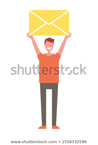 happy person holding closed letter in his hands stock photo © robuart