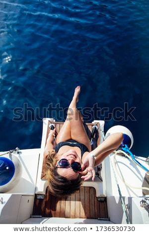 mooie · jonge · vrouw · jacht · zomer · water · zee - stockfoto © boggy