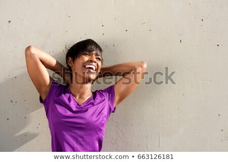 portrait of a smiling young african sportswoman stock photo © deandrobot