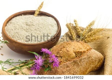 wheat grains in white ceramic bowl on sackcloth background stock photo © melnyk