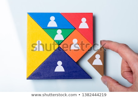 Person's Hand Completing Tangram Puzzle Stock photo © AndreyPopov