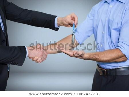 Mannen sleutel handdruk digitale composiet hand Stockfoto © wavebreak_media