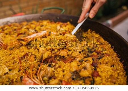 man serving a spanish chicken paella Stock photo © nito