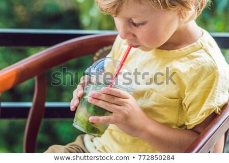 Mały chłopca napojów wody mięty wapno Zdjęcia stock © galitskaya