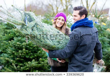 Couple carrying bought Christmas tree Stock photo © Kzenon