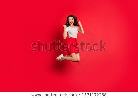 happy red haired teenage girl celebrating success stock photo © dolgachov