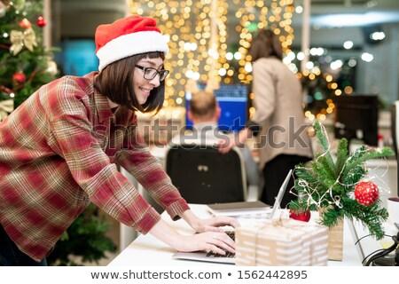 счастливым деловая женщина Cap набрав ноутбука Сток-фото © pressmaster