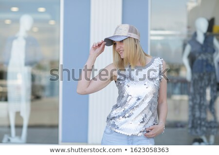 Close up of a woman with blond hair and a cap on her head Stock photo © ElenaBatkova
