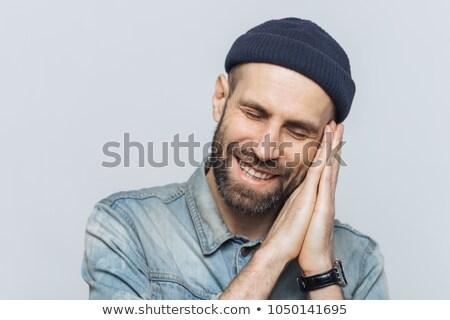 Pozitív szakállas férfi alszik kellemes álmok Stock fotó © vkstudio