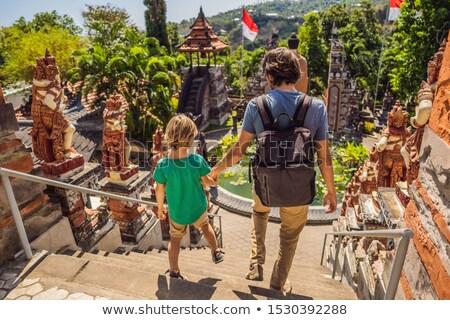 Dad and son tourists in budhist temple Brahma Vihara Arama Banjar Bali, Indonesia. Honeymoon Stock photo © galitskaya