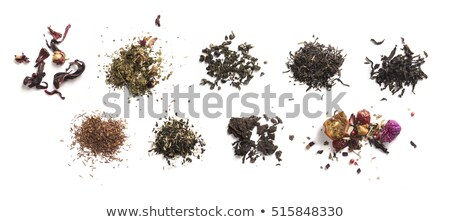 Herbal tea and accessories top view on white background Stock photo © butenkow