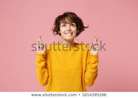 Kobieta stwarzające odizolowany palce gest obraz Zdjęcia stock © deandrobot