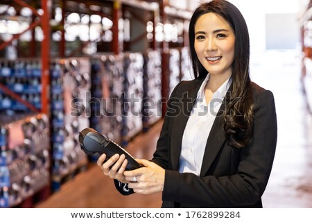 Businesswoman hold credit card reader in warehouse Stock photo © vichie81