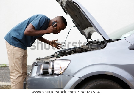 Car Driver With Engine Breakdown Calling Insurance Stock photo © diego_cervo