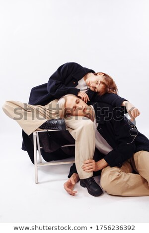 Girl with red hair embraces guy for shoulder stock photo © Paha_L
