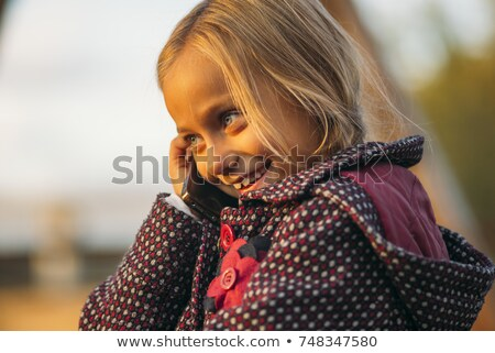 Stock photo: Blond child girl talking mobile telephone