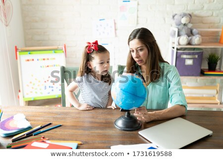 little girl learning geography with mom Stock photo © photography33