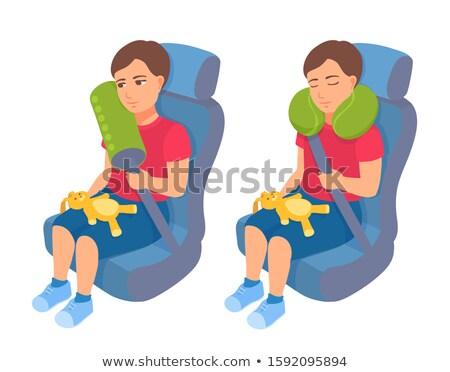Foto stock: Litle Boy Sleeps In Safe Chair In Car