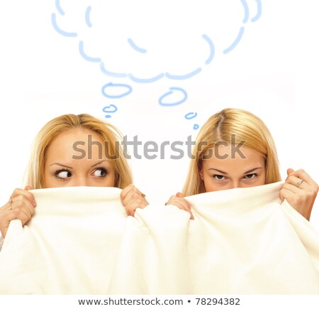 two women whispering and amazing under blanket stock photo © hasloo