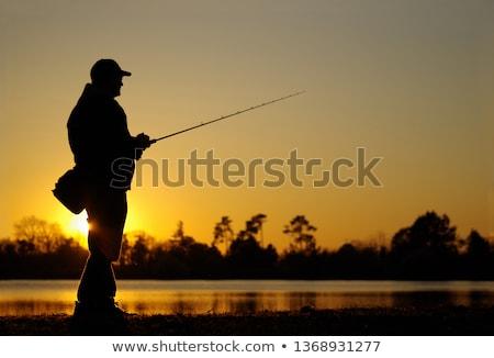 De agua dulce pescador sonrisa hombre peces verano Foto stock © photography33