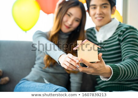 Agent and young couple with a model of a new development Stock photo © photography33