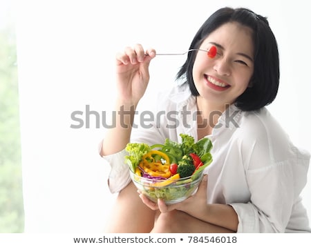 Asian woman eating apple stock photo © aremafoto