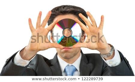 Fiatalember tart cd-k arc kompakt szemek Stock fotó © elly_l