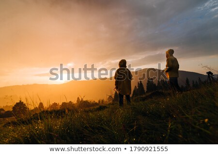 Stock photo: Two People Standing Back To Back