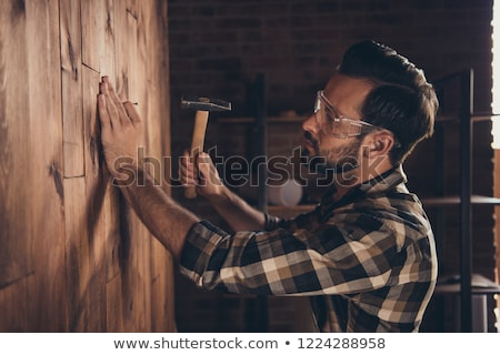 Serious handyman holding hammer Stock photo © photography33