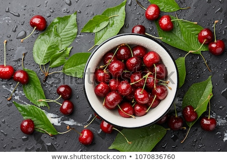 bowl of fresh ripe red cherries stock photo © klsbear