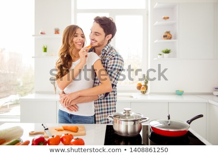 a woman feeding a carrot to her husband stock photo © photography33