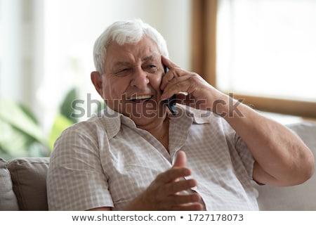 Téléphone conversation visage homme costume mobiles Photo stock © photography33