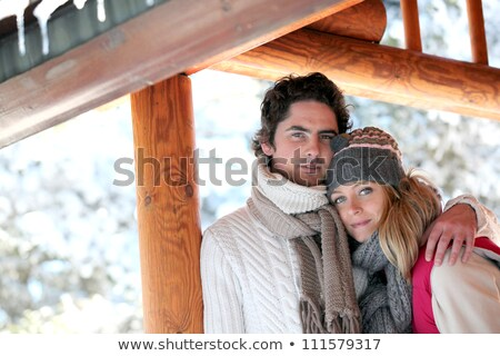 Couple stood by snow covered chalet Stock photo © photography33