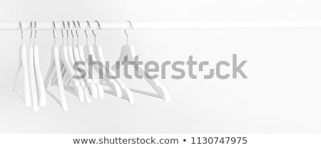 clothes rail and wooden hangers isolated on white stock photo © rtimages