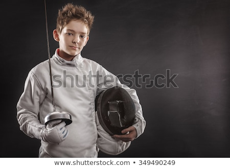 Boy in fencing costume Stock photo © zzve