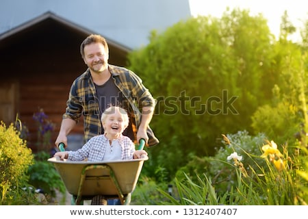 Little boy gardening with father Stock photo © photography33