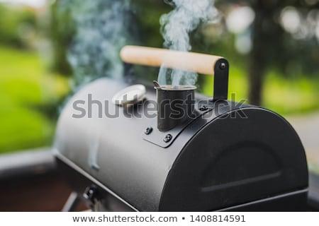 Pişirme sigara tiryakisi ızgara bütün tavuk yarım Stok fotoğraf © tdoes