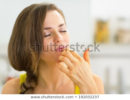 licking finger Stock photo © carlodapino